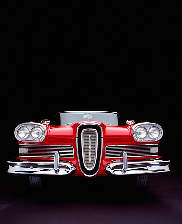 AUT 21 RK1588 03 © Kimball Stock 1958 Edsel Pacer Convertible Red And White Low Head On Shot Studio