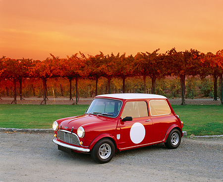 AUT 21 RK1600 06 © Kimball Stock 1959 Mini Cooper Red And White 3/4 Front View On Gravel By Vineyard Filtered