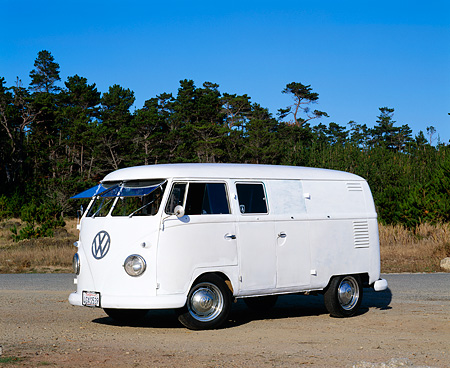 AUT 21 RK1602 02 © Kimball Stock 1957 VW Panel Double Door With Windows Safaris White 3/4 Front View On Gravel Trees Background