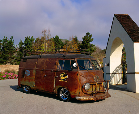 AUT 21 RK1605 02 © Kimball Stock 1954 Volkswagen Panel Bus Rusted 3/4 Front View On Pavement By Flowers And Trees