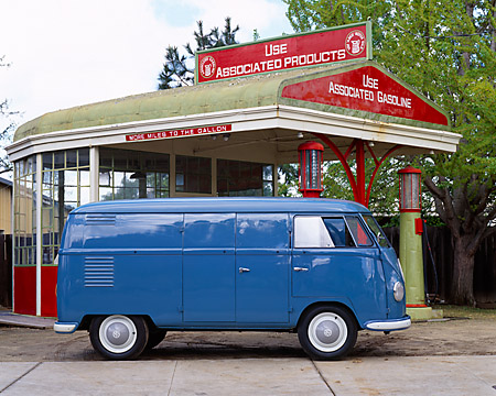 AUT 21 RK1630 02 © Kimball Stock 1954 Volkswagen Panel Van Double Doors Blue Profile On Pavement By Gas Station