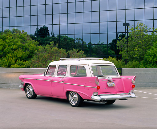 AUT 21 RK1694 03 © Kimball Stock 1958 Studebaker Station Wagon Pink 3/4 Rear View On Pavement By Glass Building And Trees