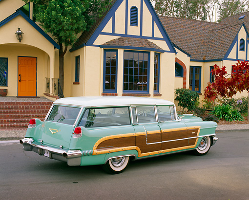 AUT 21 RK1702 06 © Kimball Stock 1956 Cadillac Woody Station Wagon Green 3/4 Rear View On Pavement By House