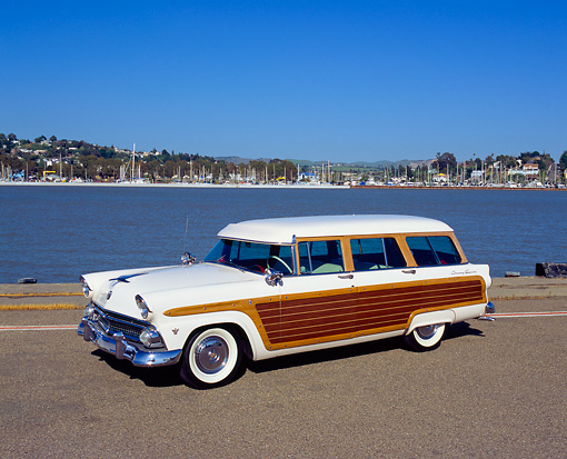 AUT 21 RK1713 02 © Kimball Stock 1955 Ford Woody Wagon White Side 3/4 View On Pavement By Water