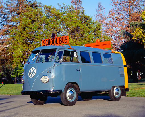 AUT 21 RK1727 02 © Kimball Stock 1955 VW School Bus Prototype Blue And Yellow Side 3/4 View On Pavement By Trees