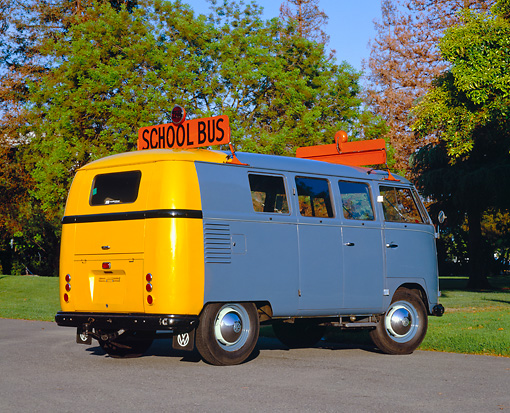 AUT 21 RK1728 02 © Kimball Stock 1955 VW School Bus Prototype Blue And Yellow Rear 3/4 View On Pavement By Trees