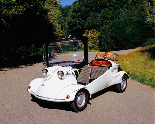 AUT 21 RK1738 02 © Kimball Stock 1959 FMR Messerschmitt Tiger Micro Car White 3/4 Front View On Pavement By Trees