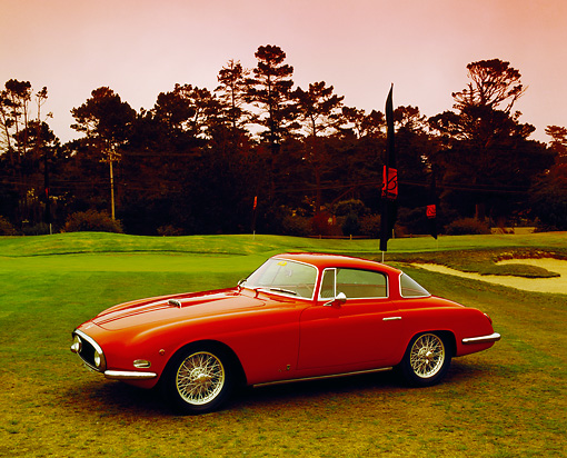 AUT 21 RK1785 02 © Kimball Stock 1954 Fiat Vignale 8V Coupe Red 3/4 Front View On Grass By Trees