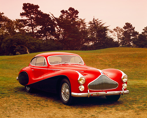 AUT 21 RK1787 02 © Kimball Stock 1951 Talbot Lago T26 Grand Sport Red And Black 3/4 Front View On Grass Trees Background
