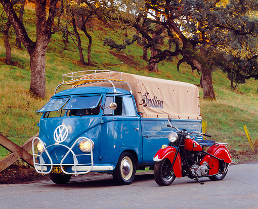 AUT 21 RK1836 04 © Kimball Stock 1954 Volkswagen Single Cab Bus Dove Blue 3/4 Front View On Pavement With 1946 Indian Chief Motorcycle