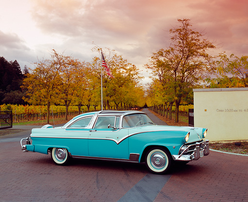 AUT 21 RK1844 01 © Kimball Stock 1955 Ford Crown Victoria Skyliner Two Tone Green 3/4 Side View On Pavement by Trees
