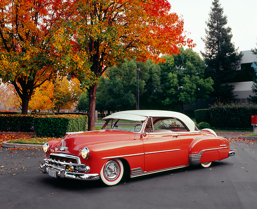 AUT 21 RK1858 02 © Kimball Stock 1952 Chevy Deluxe Salmon And White 3/4 Front View On Pavement By Fall Trees