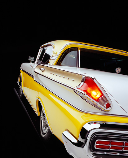 AUT 21 RK1871 06 © Kimball Stock 1957 Mercury Turnpike Cruiser Yellow And White Close Up Rear Shot Studio