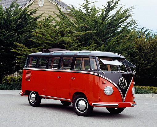 AUT 21 RK1876 03 © Kimball Stock 1955 Volkswagen 23 Window Bus Red And Brown 3/4 Side View On Pavement By Trees