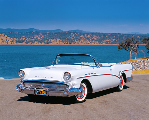 AUT 21 RK1877 01 © Kimball Stock 1957 Buick Roadmaster Convertible White 3/4 Front View On Pavement By Lake