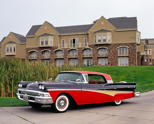 AUT 21 RK1893 01 © Kimball Stock 1958 Ford Skyliner Red And Black 3/4 Side View On Pavement By Mansion