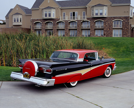 AUT 21 RK1894 03 © Kimball Stock 1958 Ford Skyliner Red And Black 3/4 Rear View On Pavement By Building