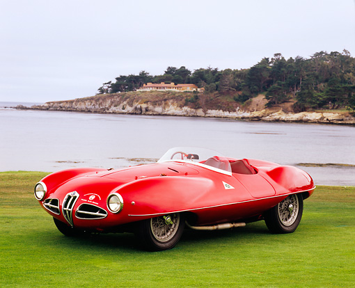 AUT 21 RK1902 02 © Kimball Stock 1953 Alfa Romeo 1900 Disco Volante Red 3/4 Front View On Grass By Water