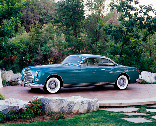 AUT 21 RK1910 01 © Kimball Stock 1953 Chrysler Ghia Teal 3/4 Side View By Rocks And Trees