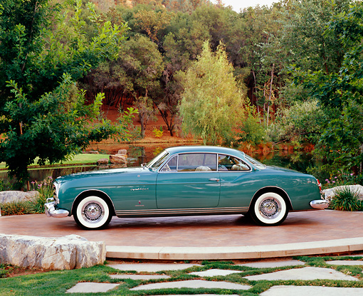 AUT 21 RK1911 05 © Kimball Stock 1953 Chrysler Ghia Teal Profile Shot By Rocks And Trees