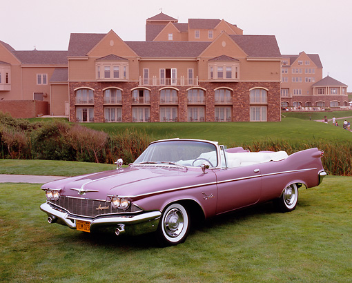 AUT 21 RK2013 02 © Kimball Stock 1959 Chrysler Imperial Crown Convertible Lavender 3/4 Front View On Grass By Building