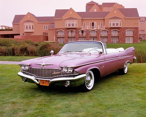 AUT 21 RK2017 01 © Kimball Stock 1959 Chrysler Imperial Crown Convertible Lavender 3/4 Front View On Grass By Building