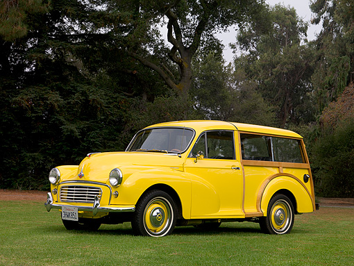 AUT 21 RK2020 01 © Kimball Stock 1959 Morris Mini Minor Traveller Yellow Woody Low 3/4 Side View On Grass By Trees
