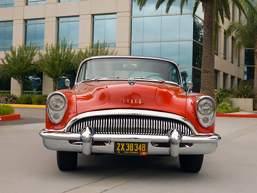 AUT 21 RK2044 01 © Kimball Stock 1954 Buick Super Red Black Top Low Head On View On Pavement