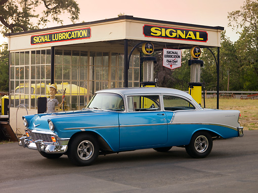 AUT 21 RK2099 01 © Kimball Stock 1956 Chevrolet 210 Blue And Silver 3/4 Side View On Pavement