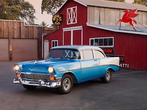 AUT 21 RK2101 01 © Kimball Stock 1956 Chevrolet 210 Blue And Silver 3/4 Front View On Pavement