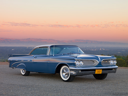 AUT 21 RK2103 01 © Kimball Stock 1959 Pontiac Bonneville Blue 3/4 Front View On Pavement
