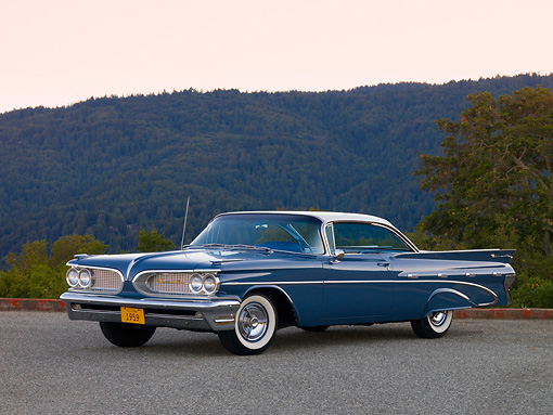 AUT 21 RK2107 01 © Kimball Stock 1959 Pontiac Bonneville Blue 3/4 Front View On Pavement
