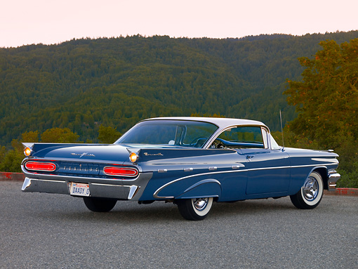 AUT 21 RK2108 01 © Kimball Stock 1959 Pontiac Bonneville Blue 3/4 Rear View On Pavement