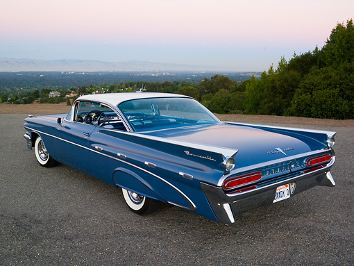 AUT 21 RK2111 01 © Kimball Stock 1959 Pontiac Bonneville Blue 3/4 Rear View On Pavement