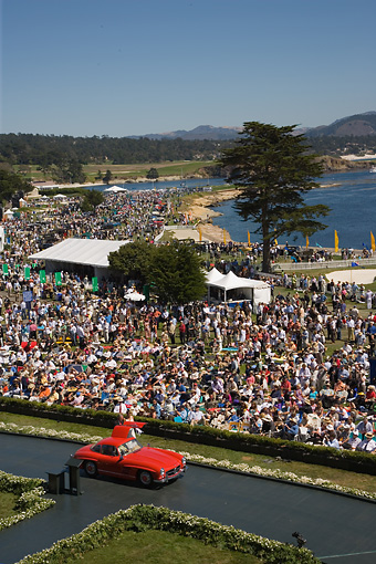 AUT 21 RK2112 01 © Kimball Stock Mercedes-Benz Red Parading By Grandstand At 2007 Pebble Beach Concours
