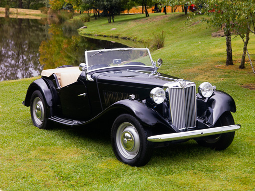 AUT 21 RK2120 01 © Kimball Stock 1950 MG TD Black Front 3/4 View On Grass By Water Trees