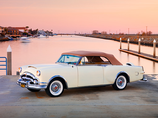 AUT 21 RK2177 01 © Kimball Stock 1953 Packard Caribbean Convertible Ivory 3/4 Front View By Water