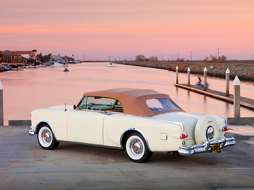 AUT 21 RK2182 01 © Kimball Stock 1953 Packard Caribbean Convertible Ivory 3/4 Rear View By Water