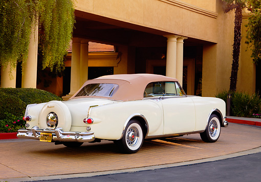 AUT 21 RK2184 01 © Kimball Stock 1953 Packard Caribbean Convertible Ivory 3/4 Rear View By Building