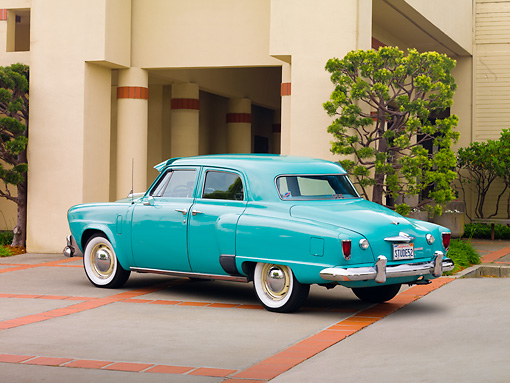 AUT 21 RK2201 01 © Kimball Stock 1952 Studebaker Commander Green 3/4 Rear View By Building