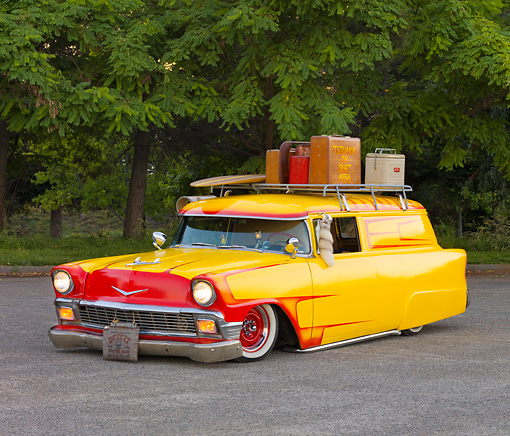 AUT 21 RK2212 01 © Kimball Stock 1956 Chevrolet Sedan Delivery Yellow 3/4 Front View By Trees