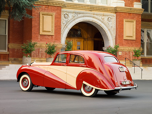 AUT 21 RK2217 01 © Kimball Stock 1951 Bentley Mk VI Harold Radford Countryman Saloon Maroon & Tan 3/4 Rear View By Building