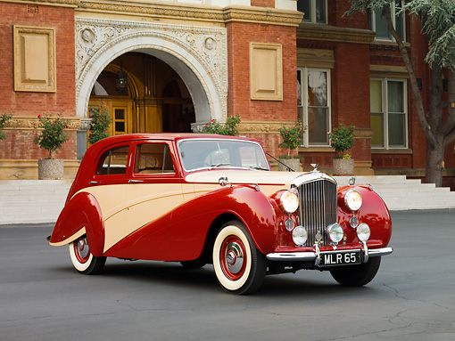 AUT 21 RK2219 01 © Kimball Stock 1951 Bentley Mk VI Harold Radford Countryman Saloon Maroon & Tan 3/4 Front View By Building