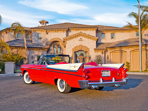 AUT 21 RK2220 01 © Kimball Stock 1957 Dodge Custom Royal Lancer Convertible Red And White 3/4 Rear View By House