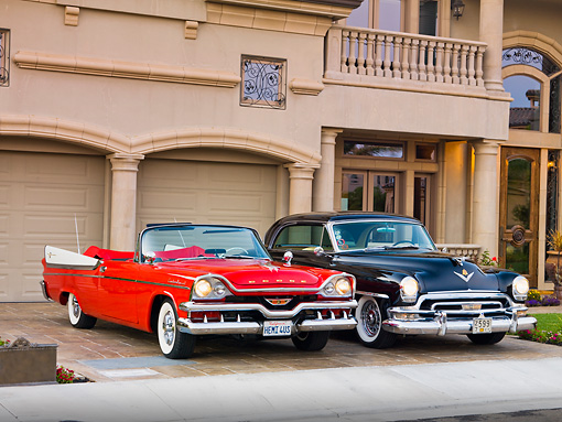 AUT 21 RK2227 01 © Kimball Stock 1957 Dodge Custom Royal Lancer Convertible And 1954 Chrysler Newport New Yorker Black 3/4 Front View By House