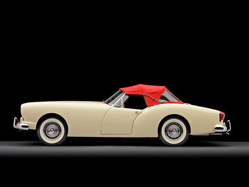 AUT 21 RK2255 01 © Kimball Stock 1954 Kaiser Darrin Convertible White And Red Profile View Studio