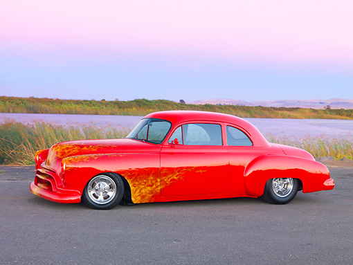 AUT 21 RK2267 01 © Kimball Stock 1950 Oldsmobile 88 Hot Rod Red With Flames Custom Coupe 3/4 Front View On Pavement By Water