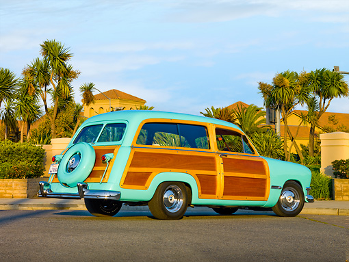 AUT 21 RK2281 01 © Kimball Stock 1950 Ford Woody Station Wagon Green 3/4 Rear View On Pavement By Palm Trees