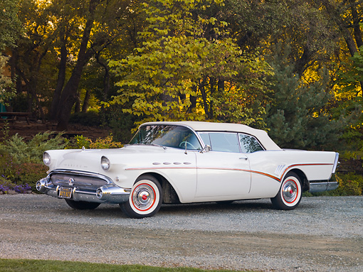 AUT 21 RK2296 01 © Kimball Stock 1957 Buick Roadmaster Convertible White 3/4 Front View On Road By Trees