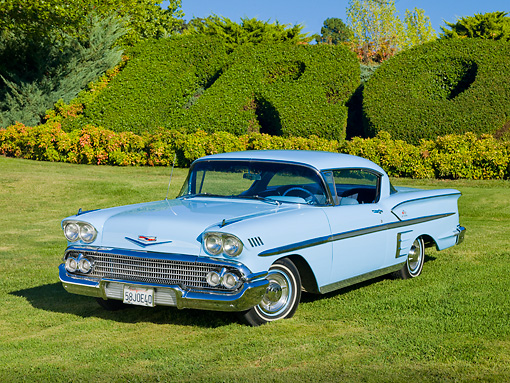 AUT 21 RK2306 01 © Kimball Stock 1958 Chevrolet Bel Air Impala Hardtop Light Blue 3/4 Front View On Grass By Hedge